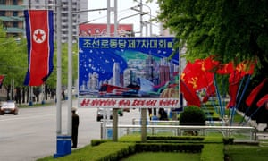A poster in Pyongyang that says 'let's greet the seventh congress of the workers' party of Korea with a high degree of political enthusiasm and brilliant labour achievements!'