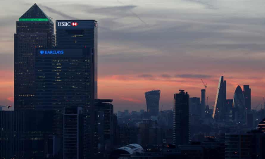 Canary Wharf and the City of London at sunset.