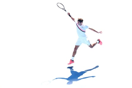 Roger Federer of Switzerland plays a backhand in his fourth round match against Marton Fucsovics