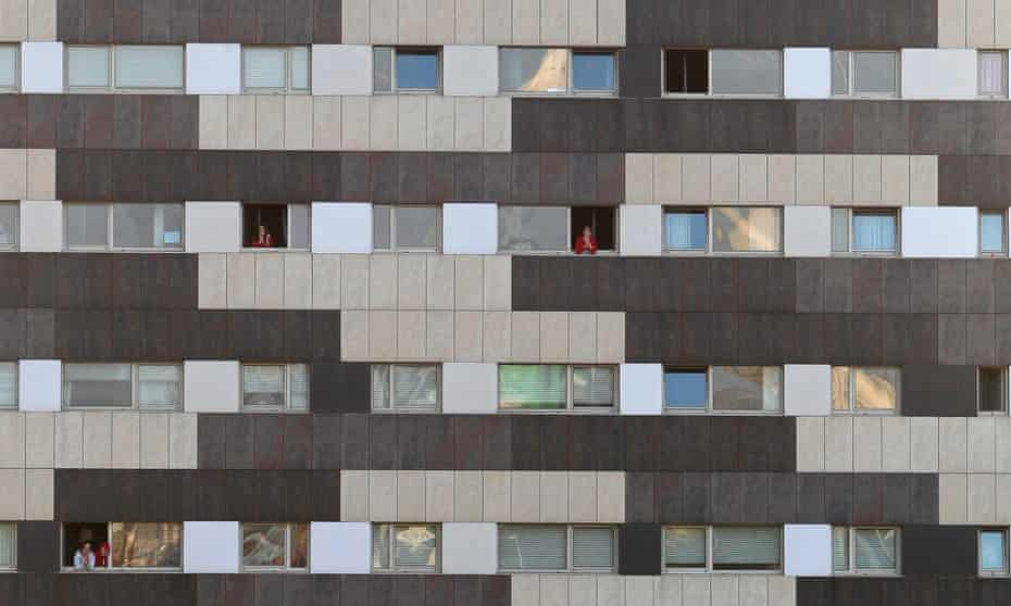 Building with women hanging from windows in Spain