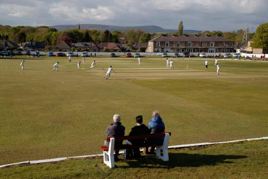 Lowerhouse v Norden in Burnley. Heaton says 'very few places in the north have cricket any more'.