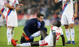 Mamadou Sakho receives treatment on his right knee against Leicester and he is now likely to need an operation.