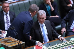 Bill Shorten talks to the manager of opposition business, Tony Burke, during debate in the house this afternoon