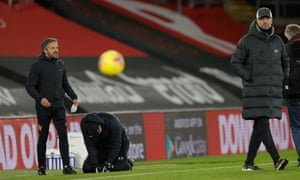 Ralph Hasenhüttl (second left) sinks to his knees in tears at the full-time whistle as Jürgen Klopp walks away.