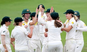 Australia's Jess Jonassen celebrates with team mates after taking the wicket of England's Natalie Sciver.