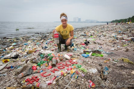 Greenpeace Canada Oceans campaigner Sarah King with a collection of Coca-Cola bottles and caps found on Freedom Island, Philippines