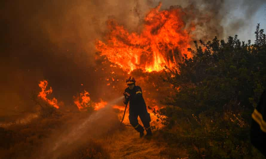 A firefighter battles to extinguish a fire in the village of Markati, near Athens, on August 16, 2021.