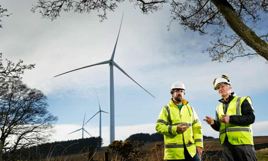 Alan Hobbett of Berwickshire Housing Association, left, with Jamie Adam of Community Energy Scotland at Hoprigshiels windfarm near Cockburnspath, Scotland