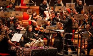 tabla maestro Zakir Hussain, centre, with the Symphony Orchestra of India conducted by Zane Dalal at Symphony Hall, Birmingham.