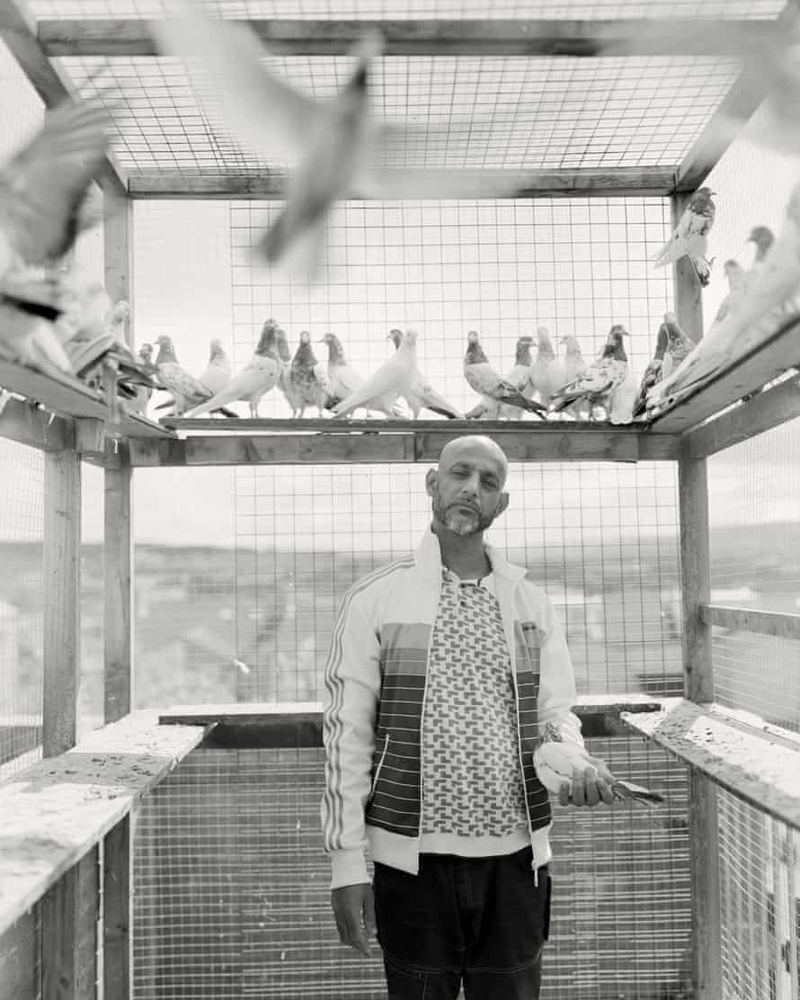 Mohammed Afzal with his pigeons in one of several cages he keeps on the tiny back terrace of his house in Johnson Street, Bank Top.