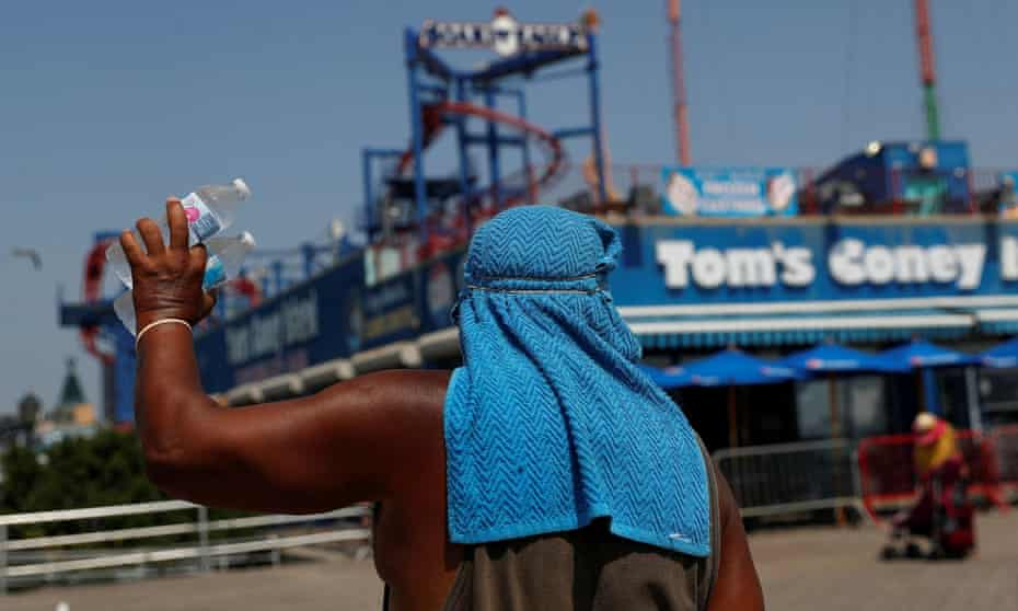 A man sells water on the boardwalk of Coney Island in New York last month.