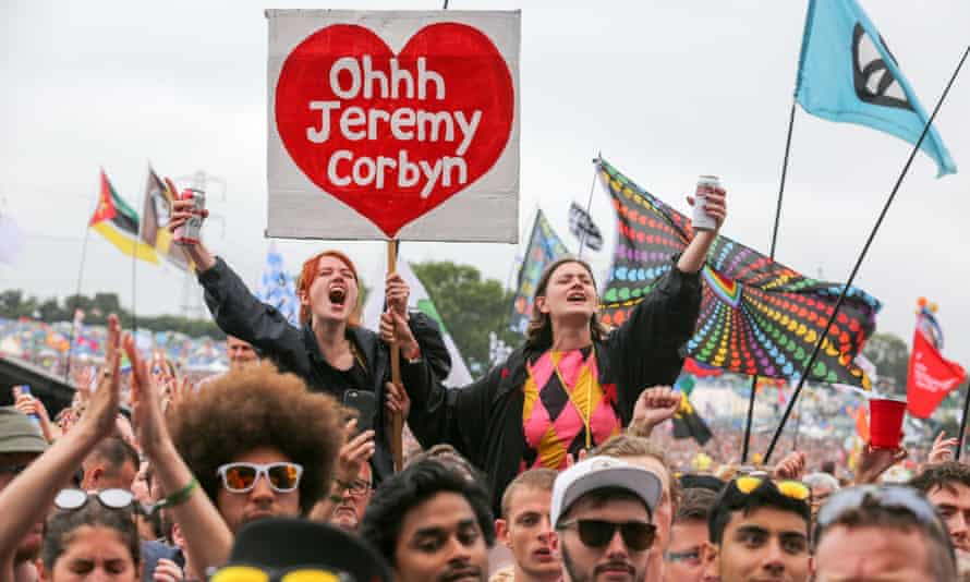 Young Corbyn supporters cheer during the Labour leader's appearance at the 2017 Glastonbury festival.