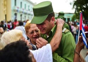 Santa Clara, Cuba: A soldier is comforted