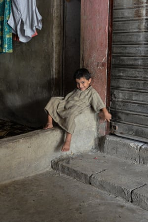 A young boy sits inside the factory