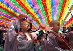 Seoul, South Korea A novice monk holds a lotus flower during a ceremony at Jogye temple