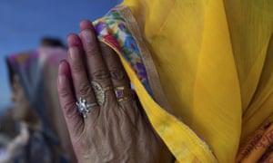 A woman prays at a Hindu temple
