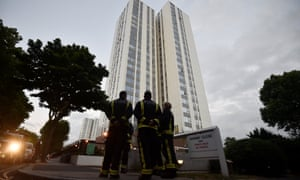 Firefighters outside Burnham tower block on the Chalcots estate, one of the four evacuated on Friday evening.