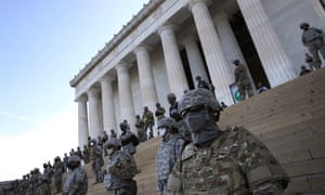 Members of the DC national guard stand on the steps of the Lincoln Memorial as demonstrators participate in a peaceful protest.