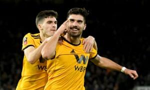 Wolverhampton Wanderers' Ruben Neves celebrates scoring their second goal.