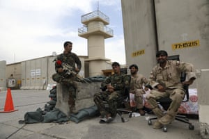 Afghan security forces keep watch at the base.