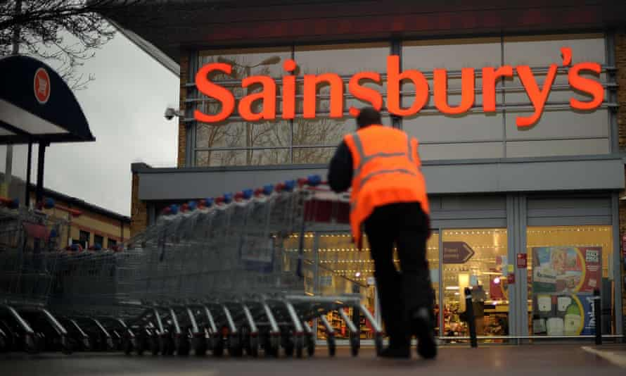 Sainsbury's supermarket exterior with trolleys and logo