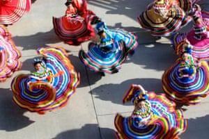 A Folklorico dance group based in Albuquerque performs outside Isotopes Stadium before the Salt Lake Bees game in New Mexico, US