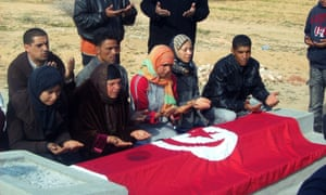 Relatives of Mohammed Bouazizi praying at his grave.
