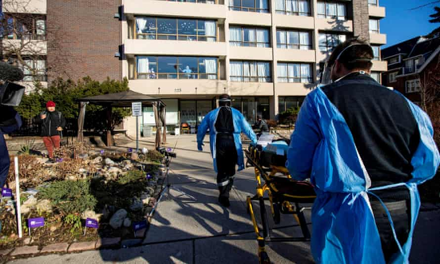 Paramedics arrive on 6 January as long-term care workers protest to demand that Sienna, a for-profit long-term care corporation, invest more to fight a coronavirus outbreak.