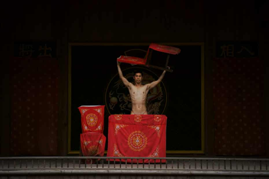 Detail of the photographer, naked, on an empty stage at a theatre in China by Shen Wei