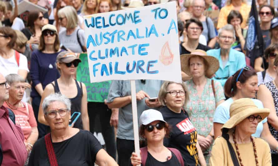 Climate crisis protester holding sign