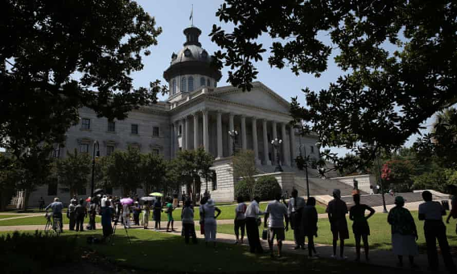 People wait to pay their respects at the statehouse on 24 June 2015 in Columbia, South Carolina, to state senator Clementa Pinckney, who was murdered in the Charleston shooting.