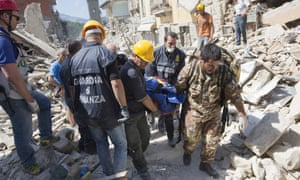 Rescuers carry a person from the rubble.