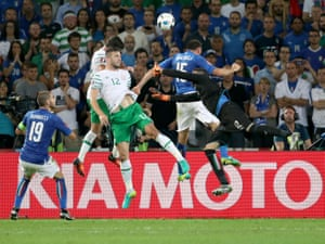 Republic of Ireland's Shane Duffy attempts a header past Italy goalkeeper Salvatore Sirigu.