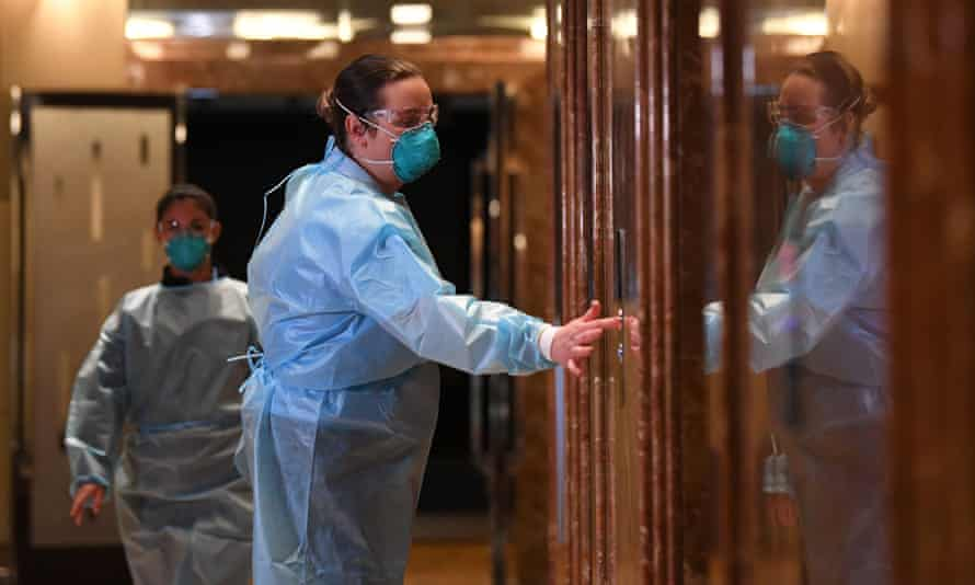 Healthcare workers inside the Grand Hyatt in Melbourne