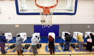 Citizens vote on a basketball court in the 8 November election, which gave the state a new Democratic majority.