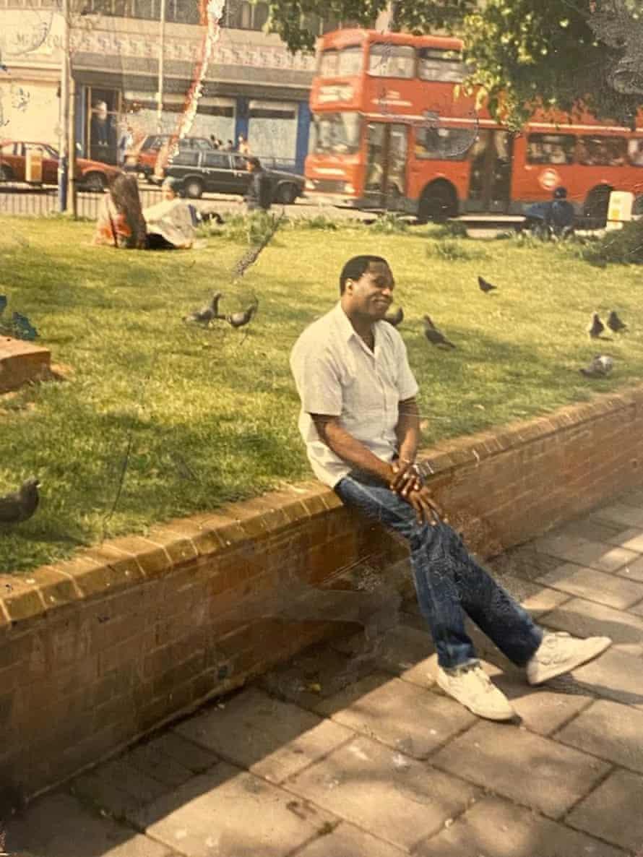 Patrick Liverpool sitting on a wall, Brixton
