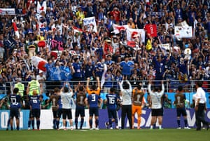 Japan celebrate with fans after their 2-1 victory.