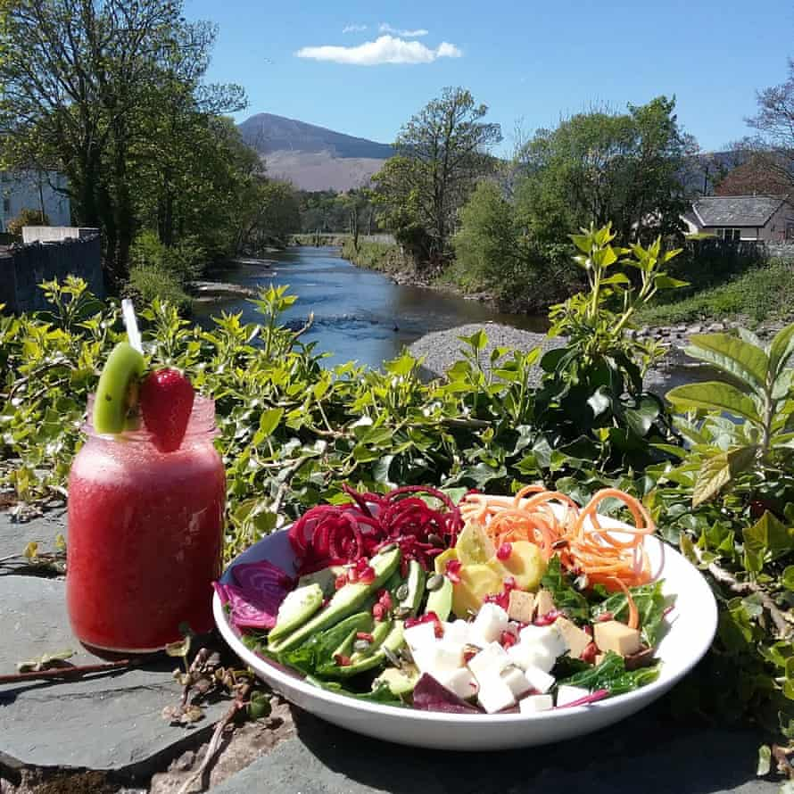 Fruit smoothie in a mason jar and a bowl of vegetarian food from Kat's Kitchen, Kewsick, Cumbria.