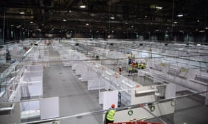Workers set up the NHS Louisa Jordan field hospital at the Scottish Events Campus to potentially help with Covid-19 patients in Glasgow.