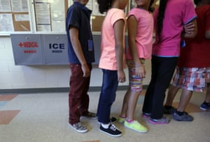 Children line up in the cafeteria at the Karnes center.