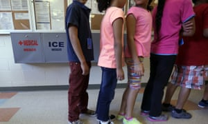 Detained immigrant children line up in the cafeteria at the Karnes county residential center, a temporary home for immigrant women and children detained at the border in Karnes City, Texas.