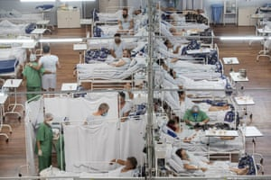 Sao Paulo, BrazilCoronavirus patients lie on beds at a field hospital built inside a sports coliseum in Santo Andre, on the outskirts of Sao Paulo