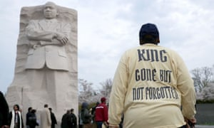 Marchers gather at the Martin Luther King Memorial for a silent walk to a prayer service on the National Mall to mark the 50th anniversary of King's assassination on 4 April 2018 in Washington DC.