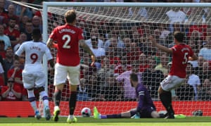 Jordan Ayew slots in the opening goal at Old Trafford.