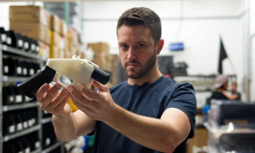 Cody Wilson holds a 3D-printed gun in his factory in Austin, Texas on 1 August 2018.