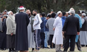 Friends and relatives arrive to attend the burial ceremony of the victims of the mosque attacks.