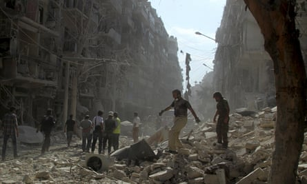 People look for survivors after a bombing in Aleppo, Syria