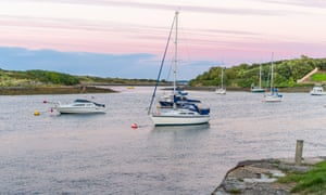 A pale pink sky over Strangford Lough, Northern Ireland.