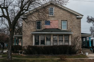 An American flag hangs on a house on Tuesday, Jan. 14, 2019 in downtown Monroe, Mich. Erin Kirkland for the Guardian