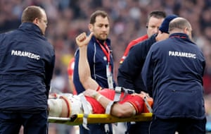 Sam Warburton gives the thumbs up as he is stretchered off.